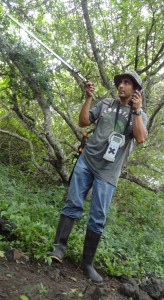 Freddy Villamar tries to locate a tortoise in the thick brush.