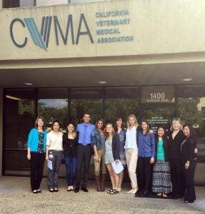 In front of the CVMA headquarters in Sacramento, from left to right: Valerie Fenstermaker, Vicky Yang, Elizabeth Malcolm, Grant Miller, Roxana Bordbar, Julie Dobbs, Audrey Buatois, Elizabeth Tenborg, Christina Thompson, Jenny Tsai, Christina DiCaro, Della Yee.